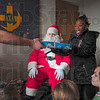 Tribune-Star/Joseph C. Garza<br /> Making spirits bright: Nine-year-old Diamond Clark can't help but smile as she accepts a present from a member of the Lambda Chi Alpha fraternity on the Rose-Hulman campus Saturday. Looking on with other children is Santa's helper and fellow Lambda Chi Alpha member, Ben McNees.