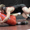 Back attack: South's P.J. Montgomery attacks Plainfield's Tyler Williams during Saturday's event at Northview. Montgomery won the match to remain undefeated.