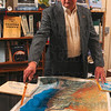 Tribune-Star/Joseph C. Garza<br /> An impacted area: Retired Indiana State professor Bill Dando points to a map of the Dead Sea and, in particular, an area where land is now exposed because of evaporation of the sea Friday in his office on the Indiana State campus.