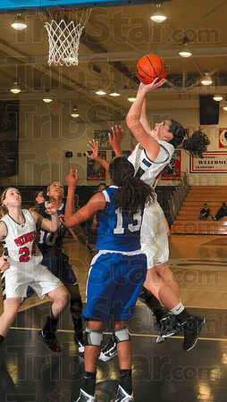 Tribune-Star/Joseph C. Garza<br /> Rebound and score: Terre Haute North's Nicole Anderson shoots after grabbing a rebound against the Ben Davis defense Saturday at North.