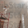 Tribune-Star/Joseph C. Garza<br /> Winter coat: Don Baysinger of Crafton Painting and Decorating smoothes out a coat of paint on the ceiling of the Poland Historic Chapel Tuesday in Poland.