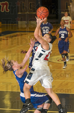 Tribune-Star/Joseph C. Garza<br /> Shooting over Giants: Terre Haute North's Jenny Barnhill shoots over a falling Ben Davis opponent during the Patriots' game against the Giants Saturday at North.