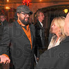 Tribune-Star/Joseph C. Garza<br /> Back home among friends: Milan Chakraborty, producer of Rock Slyde, talks with friends Desiree Gregg and Rick Kelly before the movie's premiere at the Indiana Theater Saturday afternoon.