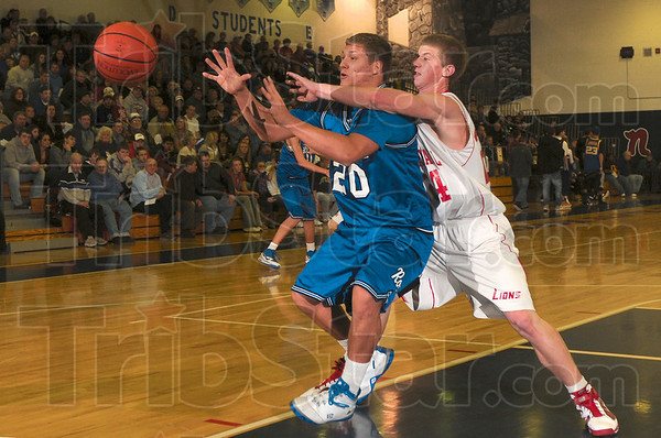 Tribune-Star/Joseph C. Garza<br /> Ring around the collar defense: Marshall's Jake Tucker tries to block the inbound pass to Rockville's David Parsons during the teams' Pizza Hut Wabash Valley Classic at Terre Haute North.