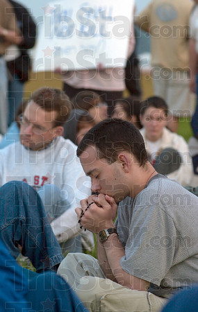 Tribune-Star file photo/Joseph C. Garza<br /> Silent prayers: An anti-death penalty protester prays among fellow participants an hour before Timothy McVeigh's execution Monday, June 11, 2001 at the federal penitentiary.