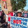 "Tribune-Star file photo/Joseph C. Garza<br /> No more killing: Participants in an anti-death penalty march chant ""No more killing"" on their way to the federal penitentiary Sunday, June 10, 2001."