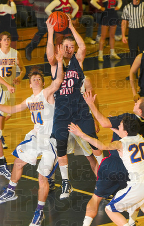 Tribune-Star/Joseph C. Garza<br /> Pulling it down: Terre Haute North's Logan Shipley pulls down a rebound as Casey-Westfield's Chris Unzicker reaches for the strip during the teams' Pizza Hut Wabash Valley Classic game Saturday at North.