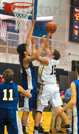 Tribune-Star/Joseph C. Garza<br /> Back up for two: South Vermillion's Patrick Harpenau puts up a shot against Sullivan's Rhett Smith during the Wildcats' game against the Golden Arrows Saturday at Terre Haute North.