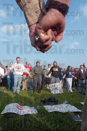 Tribune-Star file photo/Joseph C. Garza<br /> 7 a.m. in Terre Haute: Anti-death penalty demonstrators hold hands in a circle as they observe a moment of silence at the time of Timothy McVeigh's execution Monday, June 11, 2001 on the grounds of the federal penitentiary.