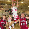 Tribune-Star/Joseph C. Garza<br /> Off the fast break: Terre Haute South's John Michael Jarvis avoids the defense of Bloomfield's Payton Karl and Andy Cochrane during the Braves' win Saturday at Terre Haute North in the first game of the Pizza Hut Wabash Valley Classic.