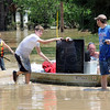 Tribune-Star file photo/Bob Poynter<br /> Big screen: Toad Hop residents use a boat to bring a big screen television to dry land Sunday, June 8, 2008.