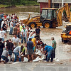 Tribune-Star file photo/Jim Avelis<br /> Defensive line: Volunteers raise a barrier of sandbags across US 40 west of West Terre Haute Saturday, June 7, 2008.