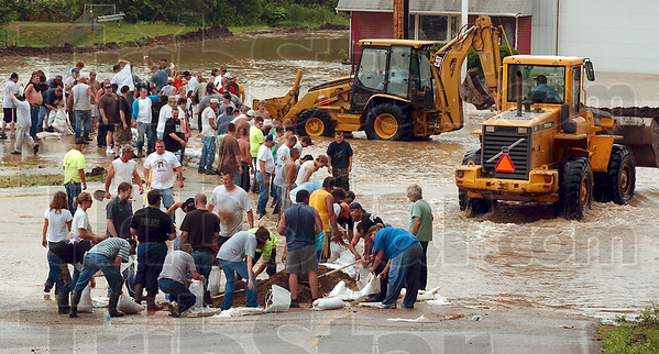 Tribune-Star file photo/Jim Avelis<br /> Defensive line: Volunteers raise a barrier of sandbags across US 40 west of West Terre Haute Saturday, June 7, 2008.