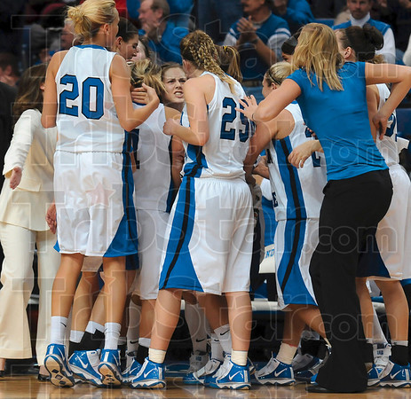 """Let's do this!"""" Indiana State's Kelsey Luna, center, tries to encourage her teammates during a timeout Wednesday during the Sycamores' game against Butler Wednesday at Hulman Center."""