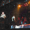 "Tribune-Star/Joseph C. Garza<br /> Back...in the spotlight: Joe Bonsall accentuates the end of a line with a kick as he and his fellow Oak Ridge Boys open their set with ""American Made"" Wednesday in Tilson Auditorium."