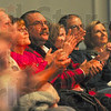 Tribune-Star/Joseph C. Garza<br /> Audience participation: Members of the audience in the front row are illuminated by stage lighting as they clap along during the Oak Ridge Boys' performance Wednesday in Tilson Auditorium.