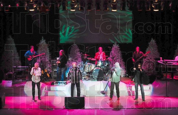 """Tribune-Star/Joseph C. Garza<br /> The Boys are back: The Oak Ridge Boys: Joe Bonsall, Duane Allen, William Lee Golden and Richard Sterban, perform """"Ozark Mountain Jubilee"""" during the first half of their Wednesday night performance in Tilson Auditorium on the Indiana State campus."""