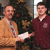 Tribune-Star/Joseph C. Garza<br /> Engineered contribution: Students with Rose-HulmanÕs Cecil T. Lobo student chapter of the American Society of Civil Engineers raised more than $2,400 this year for the Tribune-StarÕs 2009 Christmas Basket Fund. Here, Rose-Hulman senior and ASCE Treasurer Cole Perry of Columbus  hands the check to Tribune-Star Publisher B.J. Riley Wednesday at the newspaper.