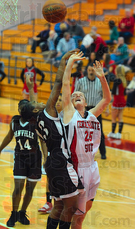 Tribune-Star/Joseph C. Garza<br /> Drivin' hard to the basket: Terre Haute South's Mikayla Metheny doesn't hesitate as she drives to the basket against Danville's Kiesha Liggins during the Braves' win Wednesday at South.