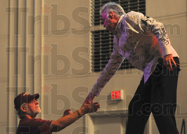 Tribune-Star/Joseph C. Garza<br /> Fan appreciation: Oak Ridge Boy Joe Bonsall shakes hands with a member of the audience at the end of the group's first song Wednesday in Tilson Auditorium.