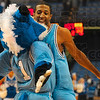 Tribune-Star/Joseph C. Garza<br /> Post-game ritual: Indiana State's Isiah Martin chest bumps mascot, Sycamore Sam, after the team's 72-59 win Wednesday at Hulman Center.