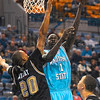 Tribune-Star/Joseph C. Garza<br /> Within reach: Indiana State's Koang Doluony shoots over IUPUI's Jon Avery during the Sycamores' win Wednesday at Hulman Center.