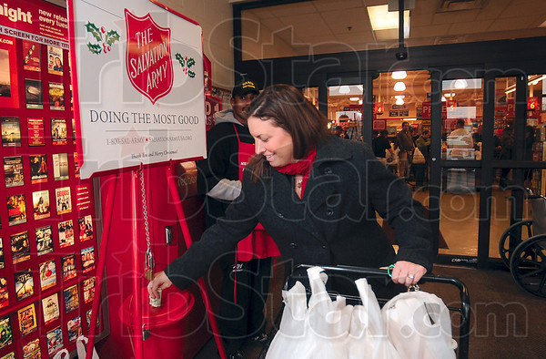 Tribune-Star/Joseph C. Garza<br /> For the Army: Cayuga resident Jill Wesch pauses before leaving Baesler's to leave a donation in the Salvation Army red kettle Wednesday.