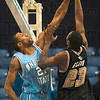 Tribune-Star/Joseph C. Garza<br /> Blue block: Indiana State's Isiah Martin blocks a shot by IUPUI's Robert Glenn during the Sycamores' win Wednesday at Hulman Center.