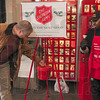 Tribune-Star/Joseph C. Garza<br /> Spreading holiday cheer: David Land stops to make a donation in the Salvation Army red kettle as volunteer bell ringer Ethan Tyler, a life member of the Greater Terre Haute NAACP, thanks him Wednesday at Baesler's.