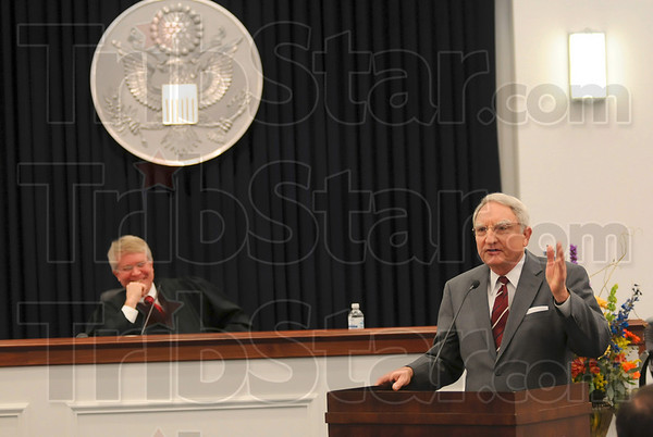 Tribune-Star file photo/Joseph C. Garza<br /> A new home: The honorable Frank J. Otte, right, U.S. Bankruptcy Court, Southern District of Indiana, shares his experiences in leaving the old federal building and settling into the new one Thursday, Nov. 12 during the United States Courthouse dedication. At left is the honorable David J. Hamilton, chief judge of U.S. District Court Southern Indiana District.
