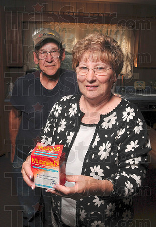 Tribune-Star file photo/Joseph C. Garza<br /> .6 over the line: Sally Harpold of Midway holds the Mucinex-D box in Sept. that she purchased in March which made her break the law by purchasing over 3.6 grams of pseudoephedrine in a seven-day period. With her is her husband, Ted Harpold.