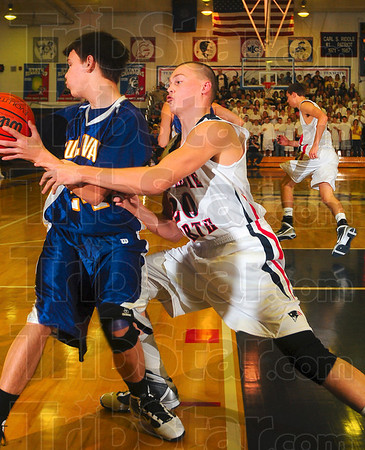Tribune-Star/Joseph C. Garza<br /> Saw it coming: Terre Haute North's Logan Shipley tries to strip the inbound pass from Sullivan's Lance Ellett during the Patriots' championship game of the Pizza Hut Wabash Valley Classic Wednesday at North.