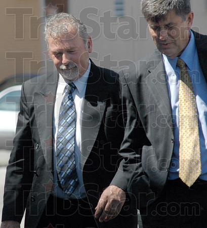 Tribune-Star file photo/Bob Poynter<br /> Sentenced: David Decker, left, walks to the Federal Courthouse with attorney William Smock for sentencing Friday, July 17.