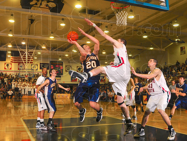 Battle of the big men: Sullivan's Rhett Smith didn't hesitate to drive nor did Terre Haute North's Justin Gant hesitate to guard him during the team's showdown in the final of the Pizza Hut Wabash Valley Classic Wednesday at North.
