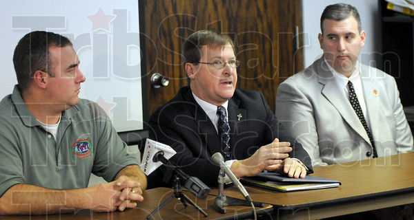 Press conference: Vigo Co. prosecutor Terry Modesitt (center) is flanked by acting police chief Shawn Keen and Terre Haute South principal Chris Mauk during a press conference Monday afternoon announcing the arrest of two juveniles for possessing a firearm on school property.