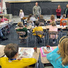 Visitor: Master Sgt. John Plasse visits with Jan Gruelach's 4th grade Lost Creek Elementary School class Monday morning. He's on a short leave from Afghanistan and will depart for the war zone on December 28th.