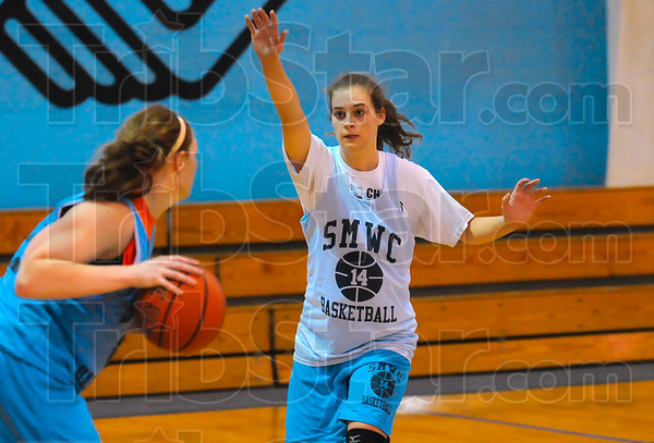 Tribune-Star/Joseph C. Garza<br /> A shooter and a defender: St. Mary-of-the-Woods' Brittney Shaner, right, leads the Pomeroys in scoring at 23 points per game. Here, Shaner guards a teammate during team practice Thursday at the Boys & Girls Club.