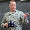 Presentation: Master Sgt. John Plasse presents a Flag to Jan Greulach's class that was used on a combat mission in Afghanistan during his visit to her Lost Creek class Monday morning.
