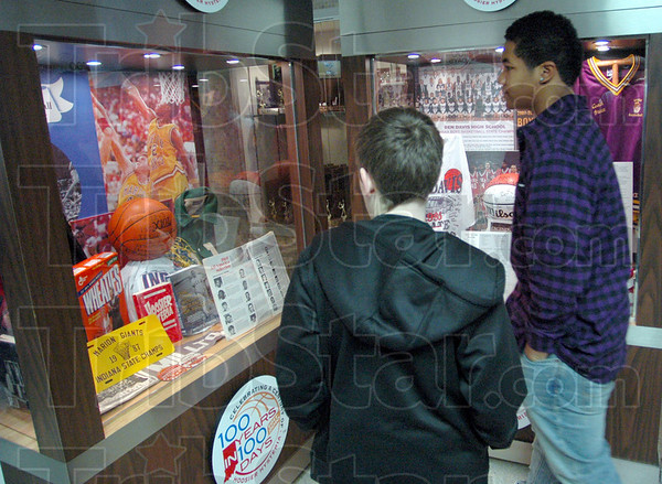 Hoosier Hysteria: Woodrow Wilson students Garrett Humphrey and Kale Walker check out the Hoosier Hysteria display at North High School Monday afternoon during half-time of the South vs. Sullivan Pizza Hut Classic game.
