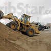 Sand and salt: City street department employees work in sand and salt piles at the street department facility Monday afternoon as they prepare for any further weather conditions that call for spreading on local streets.