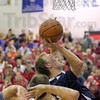 No call: North's #11, Chris O'Leary gets a push from benind as he attempts a shot during game action against Marshall Monday night. O'Leary missed the shot but officials made no call on the play.