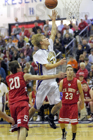 Runner: Sullivan's #31, Caleb Turner drives the lane and scores against South Vigo during Pizza Hut Classic action.