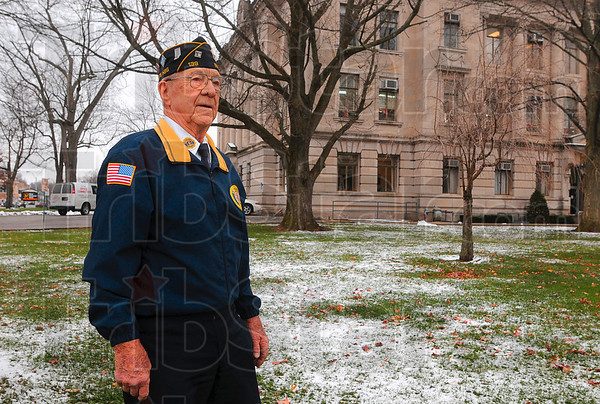 Tribune-Star/Joseph C. Garza<br /> It changed his life: World War II veteran and Sullivan resident Sonner Faught remembers that after he heard the news about the bombing of Pearl Harbor in 1941 that he left the Sherman Theater in downtown Sullivan and walked across the street to the courthouse lawn to talk with others about what they would do as the country prepared to enter a world war.