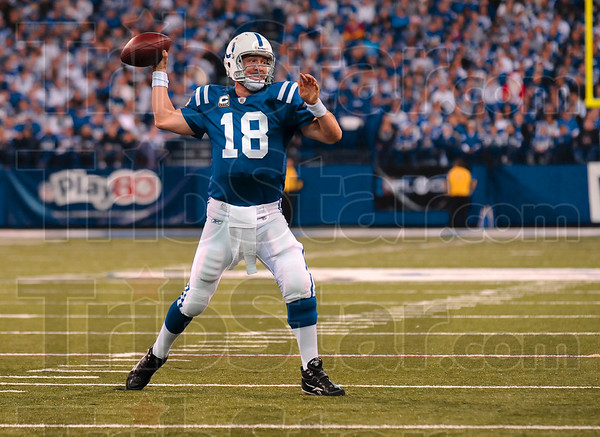Tribune-Star/Joseph C. Garza<br /> Record setter: Indianapolis quarterback Peyton Manning throws to a wide open Joseph Addai during the Colts' 27-17 win over Tennessee Sunday in Indianapolis. Manning is the first player in the NFL to throw at least 25 touchdown passes in 12 seasons in a row.