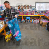 Tribune-Star/Joseph C. Garza<br /> Something a youngster would like: Sgt. Damon Ward of 3rd Battalion, 24th Marines, Kilo Co., picks out a doll for a seven-year-old girl as he prepares a package for her as part of the Toys for Tots Program Tuesday at the Wabash Valley Fairgrounds.