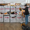 Tribune-Star/Joseph C. Garza<br /> Furry friends: Sgt. William Klemen of 3rd Battalion, 24th Marines, Kilo Co., unloads several stuffed animals Tuesday at the Wabash Valley Fairgrounds that will be available for youngsters participating in the Toys for Tots program.