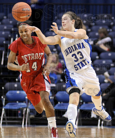 Outlet: Indiana State's #33, Kelsey Luna pushes the ball out to a running teammate durng Tuesday's game against Detroit. Detroit's #14, Lauren Allen follows the play.