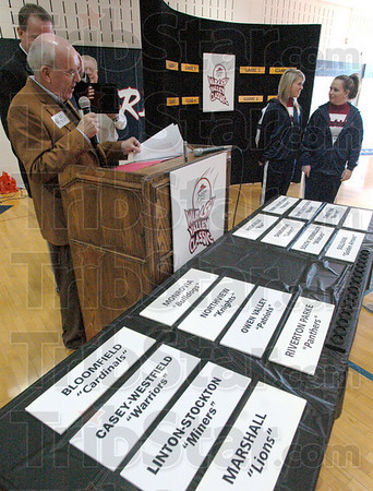 Team drawings: Pizza Hut representative Gary Fears  speaks with the attendees of the Pizza Hut Classic pairings event at North High School Tuesday afternoon.