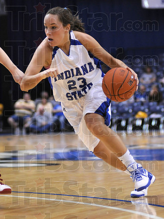 Drive: Indiana State's #23, Taylor Whitley drives the ball past a Detroit defender during first half action against Detroit.