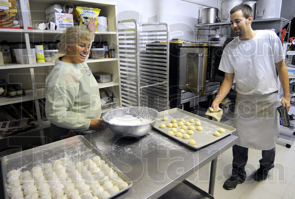 Getting started: Boo Lloyd and Jon Campbell get ready to make holiday treats Tuesday afternoon as they prepare for the Miracle on 7th Street event.